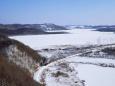 雪の釧路湿原を走るSL